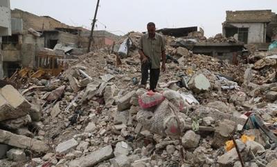 Musul'da Binlerce Kişinin Cesedi Enkaz Altından Çıkarıldı